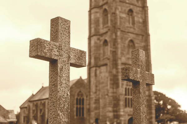 Photograph - Grave Cross With Blurred Church In Background D by Jacek Wojnarowski