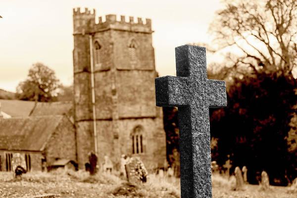 Photograph - Grave Cross With Blurred Church In Background G by Jacek Wojnarowski