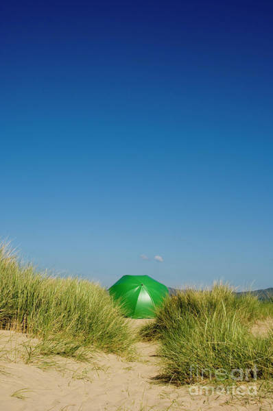 Photograph - Green Umbrella In The Sand Dunes by Keith Morris