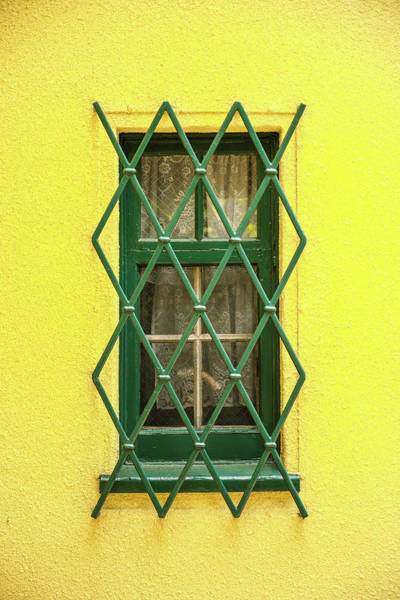Wall Art - Photograph - Green Window On Yellow Wall by Hyuntae Kim