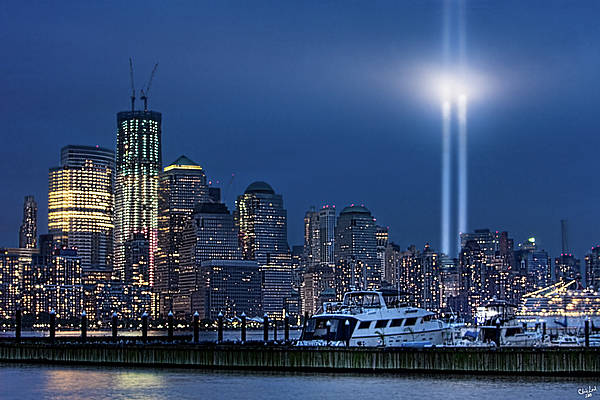 September 11 Wall Art - Photograph - Ground Zero Tribute Lights And The Freedom Tower by Chris Lord