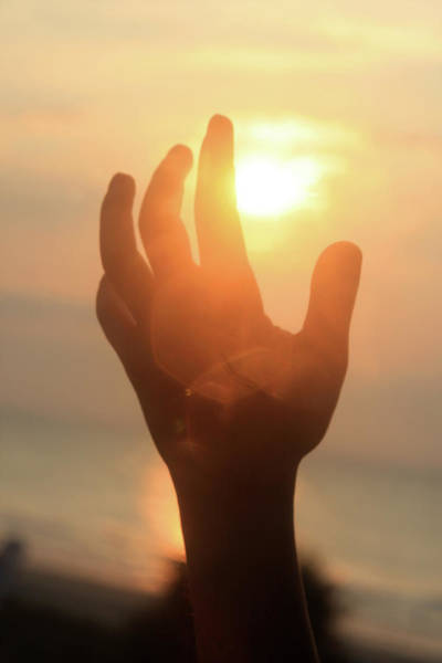 Photograph - Hand Reaching Fore The Sun by Emanuel Tanjala