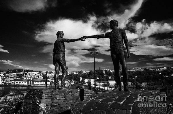 Across Photograph - Hands Across The Divide Sculpture By Maurice Harron In Derry City County Londonderry by Joe Fox