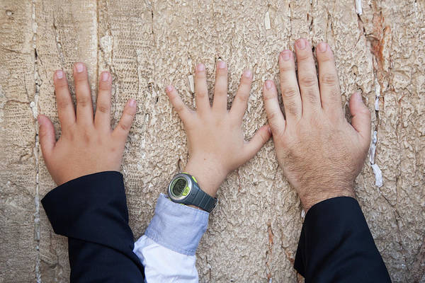 Jewish Homeland Photograph - Hands Of Dad And Son On The Wailing Wall, Jerusalem by Yoel Koskas