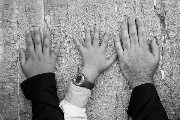Jewish Homeland Photograph - Hands Of Dad And Son On The Wailing Wall  by Yoel Koskas