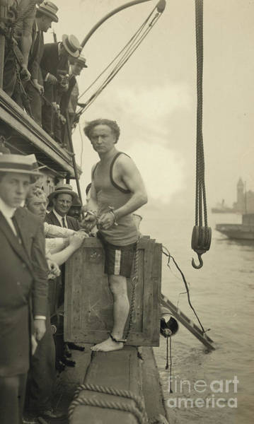 Wall Art - Photograph - Harry Houdini Stepping Into A Crate That Will Be Lowered Into New York Harbor, 1912 by American School