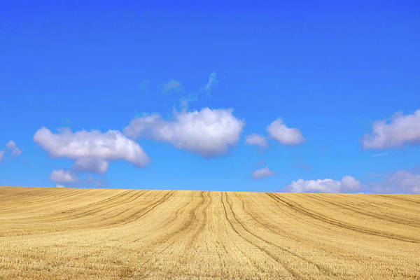 Photograph - Harvested Wheat Field And Clouds by Fabrizio Troiani
