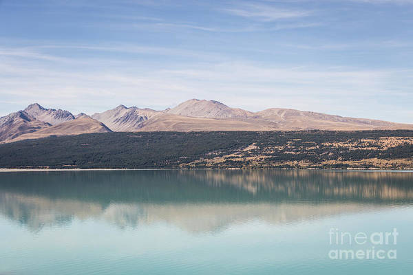 Photograph - he turquoise water of lake Pukaki in New Zealand by Didier Marti