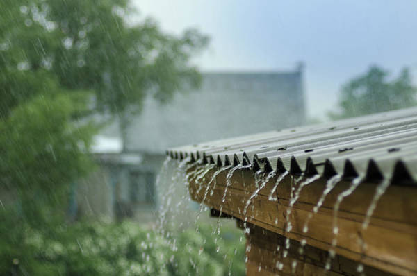 Canalization Photograph - Heavy Rain Flows Down From A Roof by Anna Nikonorova