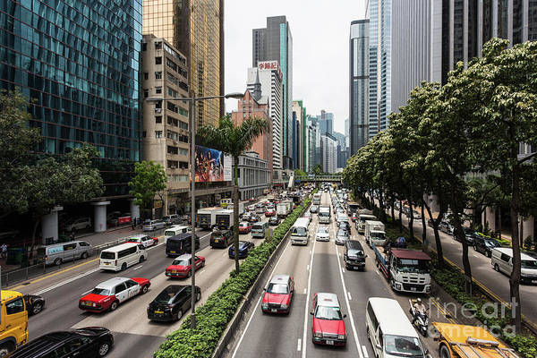 Photograph - Heavy Traffic On The Road Between The Wan Chai And Causweay Bay  by Didier Marti