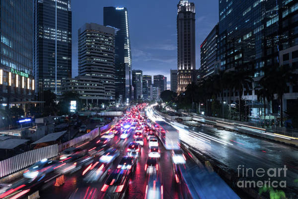 Photograph - Heavy Traffic Rushing Along The Sudirman Avenue In The Heart Of Jakarta Business District  by Didier Marti