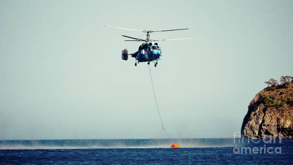 Photograph - Helicopter Firefighter Take Water In The Sea by Raimond Klavins