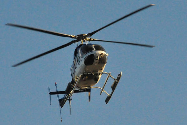 Wall Art - Photograph - Helicopter On Final Approach  by Bill Perry