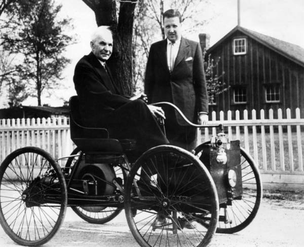 Ford Photograph - Henry Ford Sits In His First Ford Car by Everett