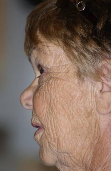 Wall Art - Photograph - Her Grandmothers Face - 2 by Dahlia Tumavicus