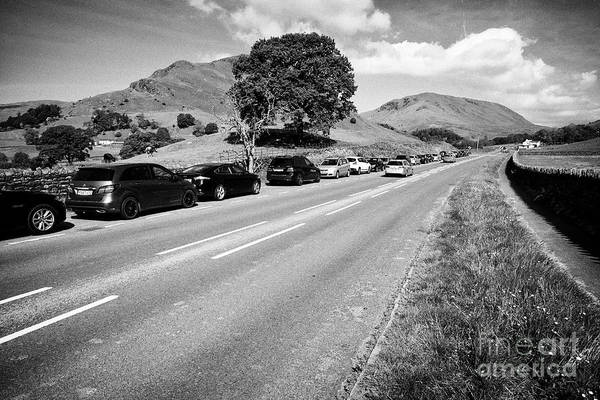 Grasmere Wall Art - Photograph - Hill Walkers Cars Parked In Layby On The A591 Road Near Fields And Hills Near Grasmere In The Lake D by Joe Fox