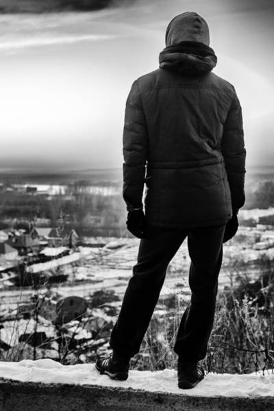 Photograph - Hooded Man Staring At The World In Monochrome Bnw by John Williams