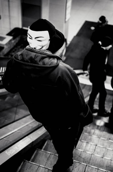 Photograph - Hooded Youth Wearing A Vendetta Mask by John Williams