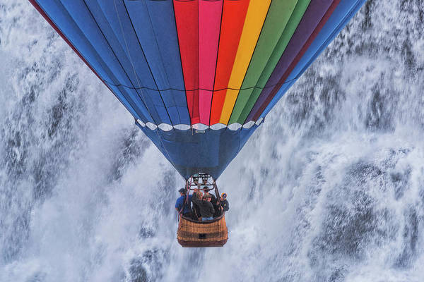 Photograph - Hot Air Balloon Decending In Front Of A Waterfall by Jim Vallee