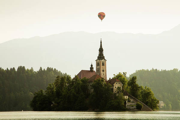 Wall Art - Photograph - Hot Air Balloon Over Lake Bled And The Island Church by Ian Middleton