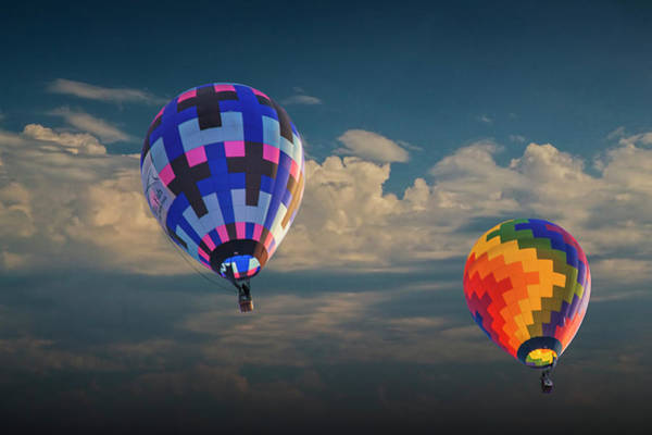 Photograph - Hot Air Balloons Against A Cloudy Sky by Randall Nyhof