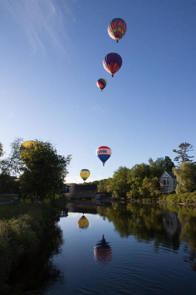 Photograph - Hot Air Balloons Playing Follow The Leader by Jeff Folger