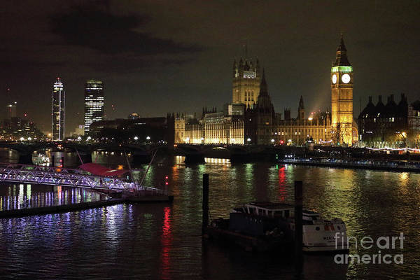 Photograph - Houses Of Parliament Reflected In The River Thames by Julia Gavin