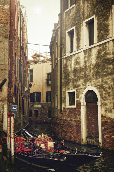Photograph - Two Empty Gondolas Surrounded By Vintage Buildings In Venice, Italy by Fine Art Photography Prints By Eduardo Accorinti