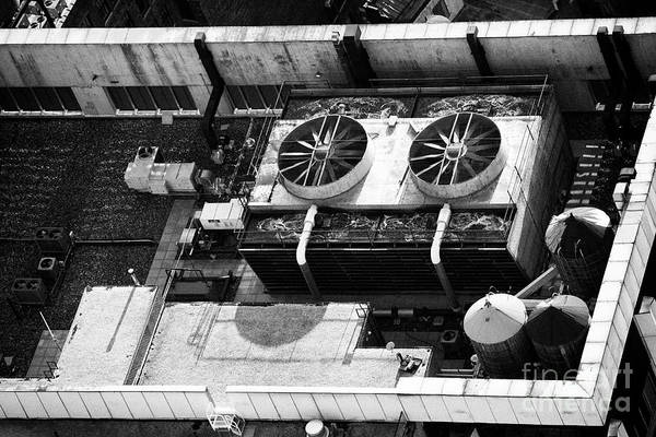 Wall Art - Photograph - Industrial Large Air Conditioning System And Wooden Water Towers On Top Of Buildings In Midtown Manh by Joe Fox