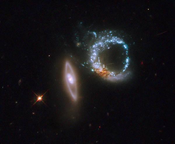 Photograph - Interacting Galaxies Arp 147 by Artistic Panda