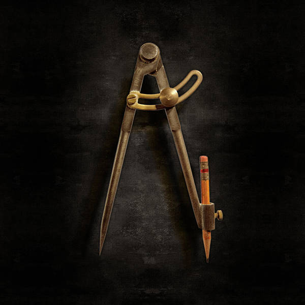 Wall Art - Photograph - Iron Compass On Black Paper by YoPedro
