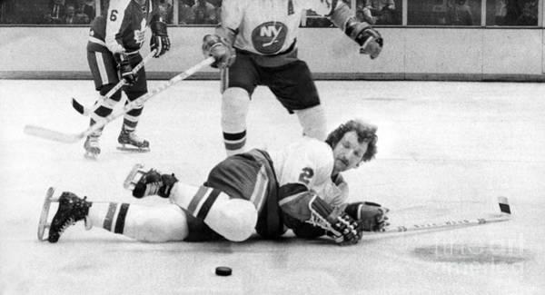 New York Islanders Photograph - Islanders Gerry Hart Blocks Maple Leafs Norm Ullman's Shots. 1974 by William Jacobellis