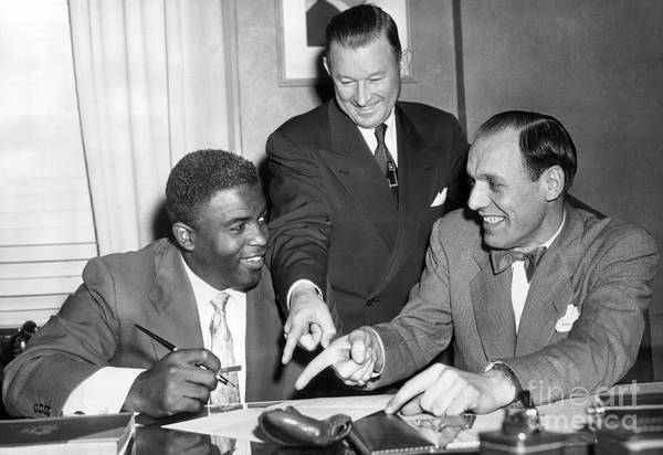 Jackie Robinson Wall Art - Photograph - Jackie Robinson Signs His 1952 Brooklyn Dodgers Contract With Buzzie Bavasi And Chuck Dressen. 1952 by Barney Stein