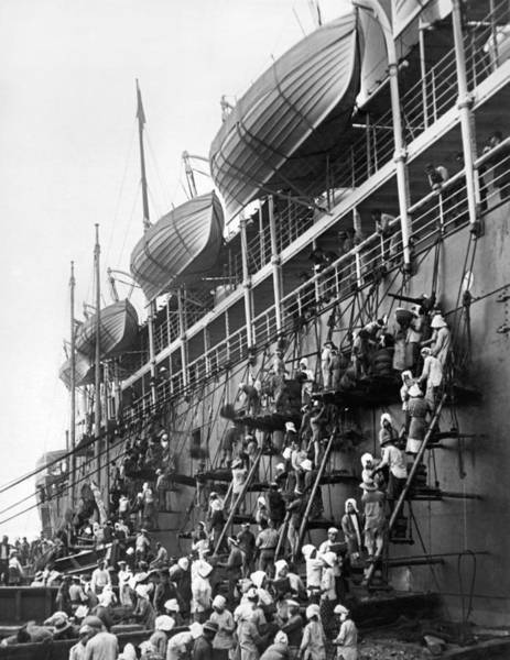 Wall Art - Photograph - Japanese Fueling A Steamship by Underwood Archives