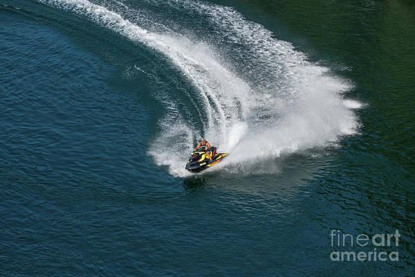 Photograph - Jet Ski On A Dark Blue Water by Les Palenik