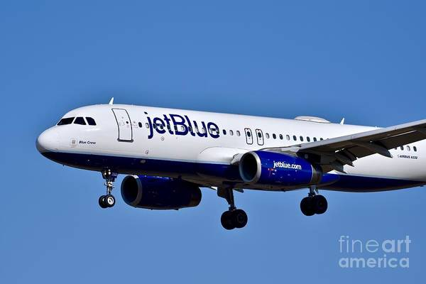 Jetblue Wall Art - Photograph - jetBlue Airlines plane in flight by Jeramey Lende