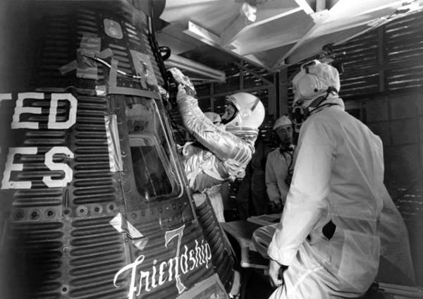 Astronaut Wall Art - Photograph - John Glenn Entering Friendship 7 Spacecraft by War Is Hell Store