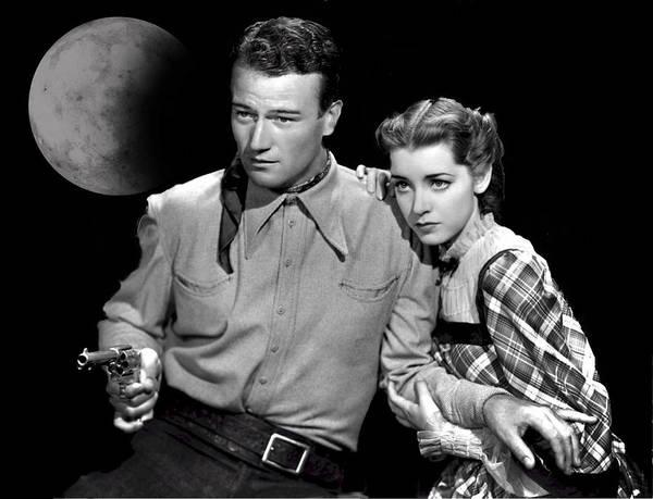 Photograph - John Wayne And Marsha Hunt by Ericamaxine Price