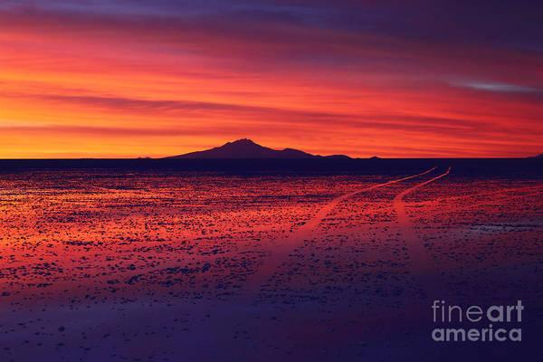 Photograph - Journey Across The Salar De Uyuni At Sunset by James Brunker