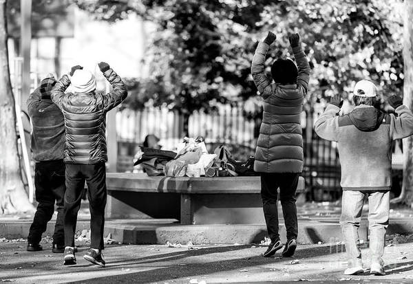 Photograph - Jump In Chinatown New York City by John Rizzuto