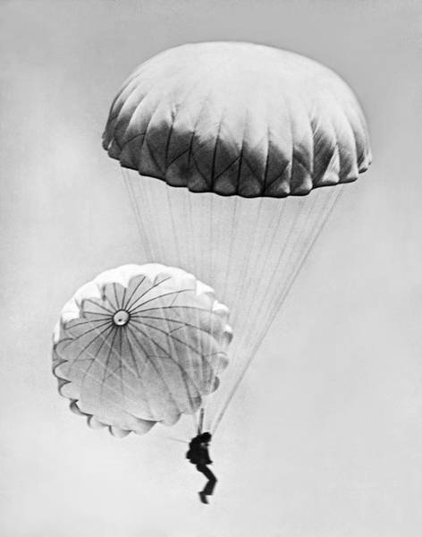Wall Art - Photograph - Jumping With Two Parachutes by Underwood Archives