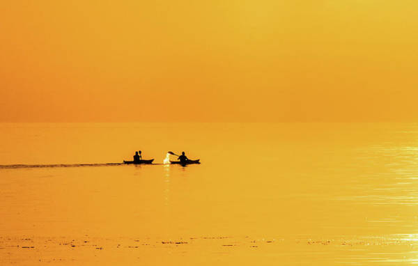 Photograph - Kayaks In The Sunset by Kim Lessel