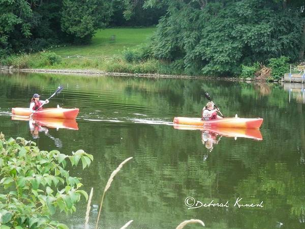 Photograph - Kayaks On The River by Deborah Kunesh