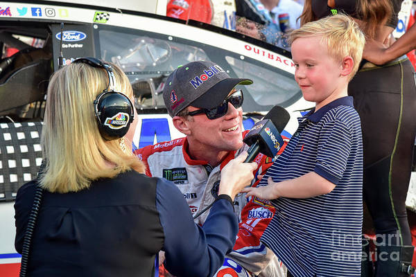 Photograph - Kevin Harvick Being Interviewed With His Son Kelaan After His Recent Victory At Texas Motor Speedway by Paul Quinn
