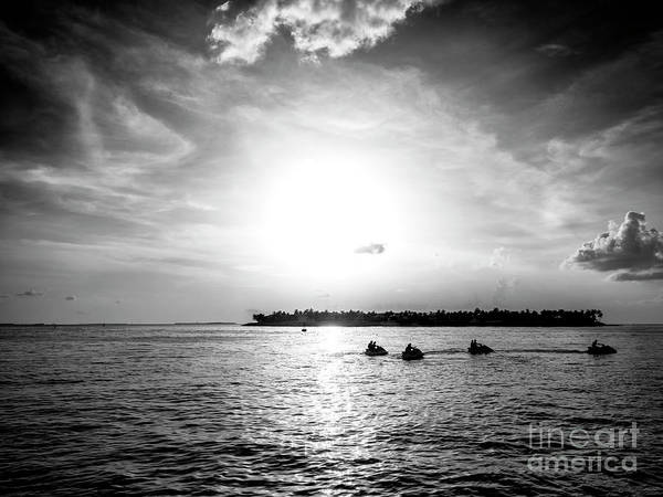 Photograph - Key West Jet Skis At Sunset by John Rizzuto