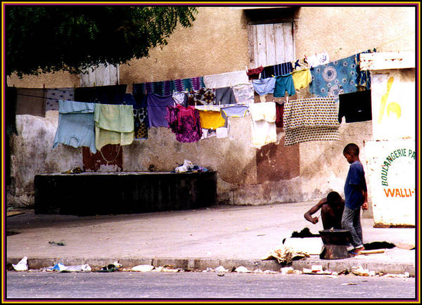 Photograph - Kids And Clothesline In Senegal by Wayne King