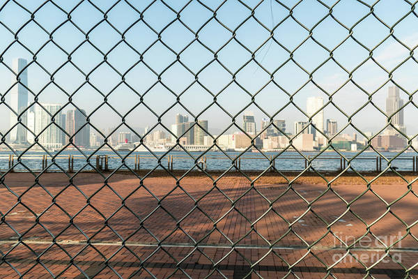 Photograph - Kowloon Skyline View Through A Fence In Hong Kong by Didier Marti