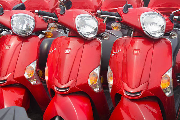 Photograph - Kymco Motorcycles by Carlos Diaz