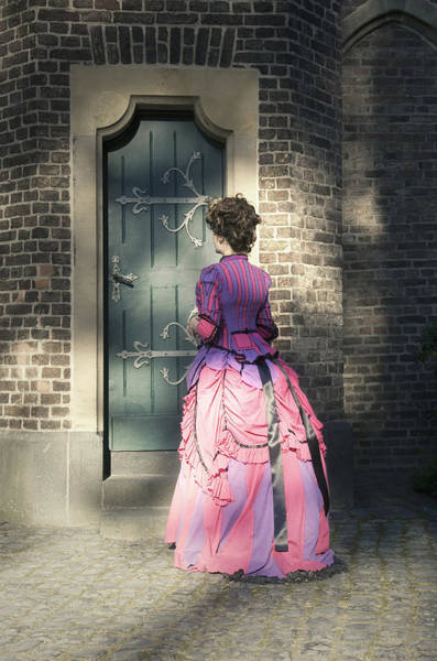 Wall Art - Photograph - Lady In Front Of Door by Luca Pudovkin