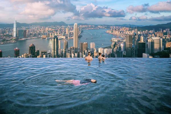 Hongkong Photograph - Lady Swim In Root Top Swimming Pool In Luxury Hotel by Anek Suwannaphoom